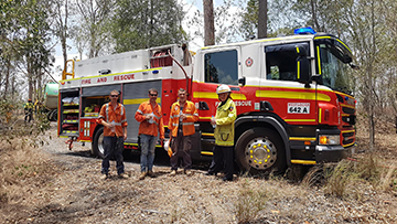 Quick thinking saves Greenbank homes from grass fire